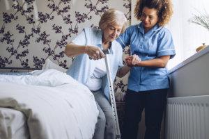 caregiver helping elder woman
