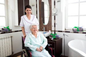 Caregiver and eldery woman in the bathroom