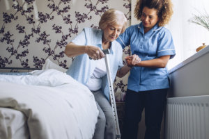 caregiver helping elder woman