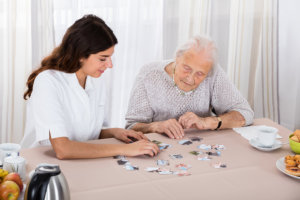 elderly woman with woman caregiver